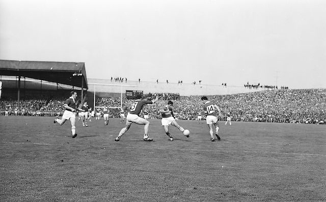 Galway's P.Griffin gets a kick at the goal during the All Ireland Senior Gaelic Football Final Kerry v. Galway in Croke Park on the 26th September 1965. Galway 0-12 Kerry 0-09.