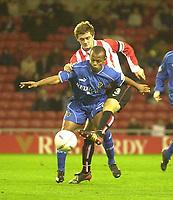 Photo. Glyn Thomas.<br /> Sunderland v Cardiff. Nationwide Division 1.<br /> Stadium of Light, Sunderland. 14/10/03.<br /> Sunderland's George McCartney (T) tackles Robert Earnshaw.