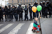 Child in front of special forces of the Czech police during a demonstration against the planned US military radar base in Czech Republic at Wenceslav square on the day of Barack Obamas participation on the EU-US summit in Prague.