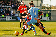 Danny Mullen of St Mirren & Martin Woods(C) of Dundee FC tangle during the Ladbrokes Scottish Premiership match between St Mirren and Dundee at the Paisley 2021 Stadium, St Mirren, Scotland on 30 March 2019.