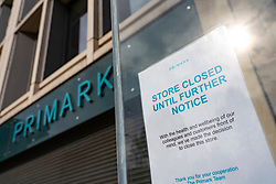 Edinburgh, Scotland, UK. 24 March, 2020.  Princes Street which is Edinburgh's main shopping street is very quiet. All shops and restaurants are closed with very few people venturing outside following the Government imposed lockdown today. Pictured; the closed Primark store. Iain Masterton/Alamy Live News