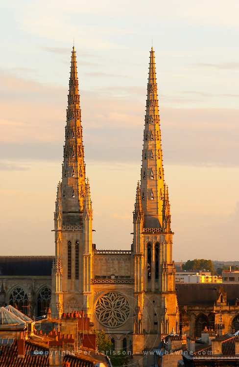 The cathedral Saint Andre in Bordeaux, 11th-12th century, with its majestic twin gothic towers at sunset, view over the rooftops