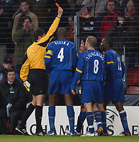 Fotball<br /> Foto: SBI/Digitalsport<br /> NORWAY ONLY<br /> <br /> UEFA Champions league.<br /> PSV Eindhoven v Arsenal<br /> 24/11/2004.<br /> <br /> Arsenal's Lauren is sent off for a second bookable offence