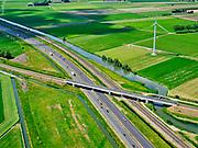 Nederland, Gelderland, Neder-Betuwe, 27-05-2020; Betuwelijn, spoorlijn vanElstviaGeldermalsennaarDordrecht.Kruising met de A15, ter hoogte van Kesteren.<br /> Betuwelijn, railway from Elst via Geldermalsen to Dordrecht. Near Kesteren.<br /> <br /> luchtfoto (toeslag op standaard tarieven);<br /> aerial photo (additional fee required)<br /> copyright © 2020 foto/photo Siebe Swart