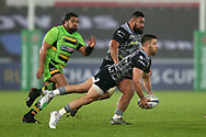 Rhys Webb of the Ospreys makes a diving pass to set up an attack. European Rugby Champions Cup, pool 2 match, Ospreys v Northampton Saints at the Liberty Stadium in Swansea, South Wales on Sunday 17th December 2017.<br /> pic by  Andrew Orchard, Andrew Orchard sports photography.