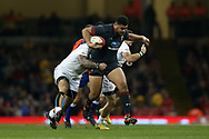Leon Brown of Wales © is tackled by Georgia' s Mikheil Naraiashvili (l) and Vasil Lobzhanidze (r).   Under Armour 2017 series Autumn international rugby, Wales v Georgia at the Principality Stadium in Cardiff , South Wales on Saturday 18th November 2017. pic by Andrew Orchard, Andrew Orchard sports photography