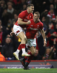 Wale's Liam Williams (right) celebrates scoring his side's first try during the NatWest 6 Nations match at the Principality Stadium, Cardiff.
