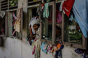 BAYEUN, ACEH, INDONESIA - JULY 11 : <br /> Woman of Rohingya migrant seen on the window at temporary shelter camp in Bayeun, East Aceh, Indonesia on July 11. 2015. The boatpeople in Aceh are among thousands of Rohingya and Bangladeshi migrants who arrived in countries across Southeast Asia in May after a Thai crackdown threw the people-smuggling trade into chaos.<br /> ©Nira Cahaya/Exclusivepix Media