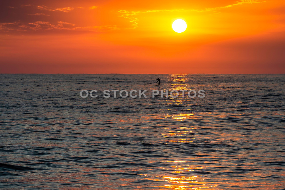Paddle Boarding Tamarac Beach At Sunset