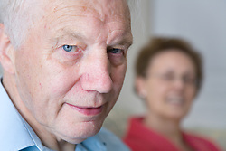 Older man at home smiling,