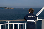 Brittany Ferries roll-on / roll-off car and vehicle ferry staff on deck on 26th September 2021 in Roscoff, Brittany, France. Brittany Ferries is the trading name of the French shipping company, BAI Bretagne Angleterre Irlande S.A. founded in 1973 by Alexis Gourvennec, that operates a fleet of ferries and cruise ferries between France and the United Kingdom.