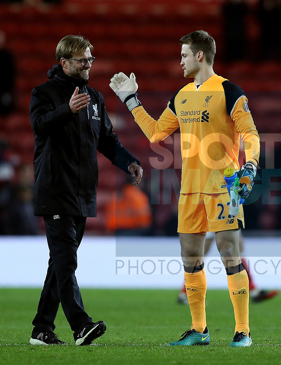 Jurgen Klopp manager of Liverpool hugs Simon Mignolet of Liverpool during the English Premier League match at the Riverside Stadium, Middlesbrough. Picture date: December 14th, 2016. Pic Simon Bellis/Sportimage