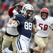 NEW HAVEN, CONNECTICUT - NOVEMBER 18: JP Shohfi #88 of Yale is tackled by Isaiah Wingfield #12 of Harvard during the Yale V Harvard, Ivy League Football match at the Yale Bowl. Yale won the game 24-3 to win their first outright league title since 1980. The game was the 134th meeting between Harvard and Yale, a historic rivalry that dates back to 1875. New Haven, Connecticut. 18th November 2017. (Photo by Tim Clayton/Corbis via Getty Images)