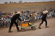 Amish family pushes a wagon during the Annual Mud Sale to support the Fire Department  in Gordonville, PA.