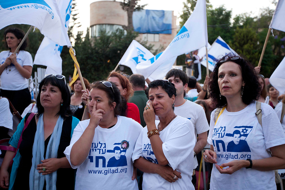 Supporters of Gilad Shalit calling for his release, react during a demonstration near Prime Minister Netanyahu's residence  in Jerusalem on June 25, 2011, as they mark five years to his captivity by Hamas militants in the Gaza Strip in 2006.