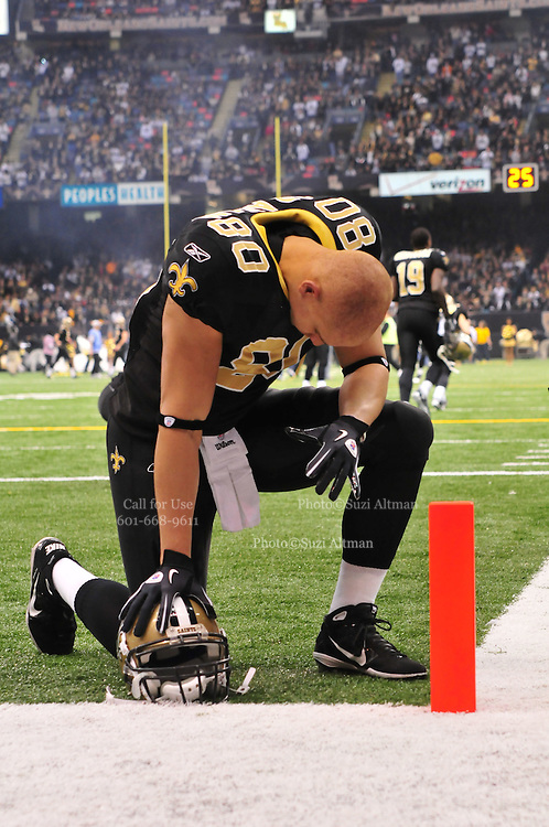 New Orleans Saints TE Jimmy  Graham takes a knee in the endzone and prays before the game against the Tampa Bay Buccaneers Sunday Jan. 2,2011. The Bucs went on to win 23-13. The New Orleans Saints play the Tampa Bay Buccaneers in the last Sunday game of the regular  season before the playoffs in New Orleans at the Super Dome in Louisiana Sunday Jan 2, 2011.Photo©SuziAltman
