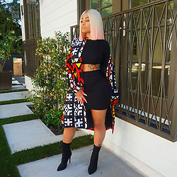"""Blac Chyna releases a photo on Instagram with the following caption: """"In love with my @dashikipride jacket. They always have me looking fly!\ud83d\ude0d"""". Photo Credit: Instagram *** No USA Distribution *** For Editorial Use Only *** Not to be Published in Books or Photo Books ***  Please note: Fees charged by the agency are for the agency's services only, and do not, nor are they intended to, convey to the user any ownership of Copyright or License in the material. The agency does not claim any ownership including but not limited to Copyright or License in the attached material. By publishing this material you expressly agree to indemnify and to hold the agency and its directors, shareholders and employees harmless from any loss, claims, damages, demands, expenses (including legal fees), or any causes of action or allegation against the agency arising out of or connected in any way with publication of the material."""