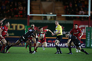 Gareth Davies of Scarlets (c) makes a break in the 2nd half but is stopped by a high tackle around his neck from Toulon's  Semi Radradra Turagasoli Waqavatu (l)  .  EPCR European Champions cup match, Scarlets v RC Toulon at the Parc y Scarlets in Llanelli, West Wales on Saturday 20th January 2018. <br /> pic by  Andrew Orchard, Andrew Orchard sports photography.