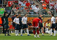 Photo: Glyn Thomas.<br />England v Trinidad & Tobago. Group B, FIFA World Cup 2006. 15/06/2006.<br /> England's Michael Owen (R) is replaced by Wayne Rooney.