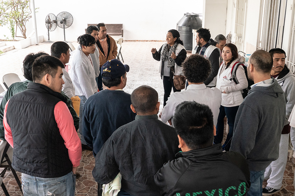Members of Doctors Without Borders speak with migrants at a shelter In Matamoros, Mexico. Photo by Ken Cedeno/UPI