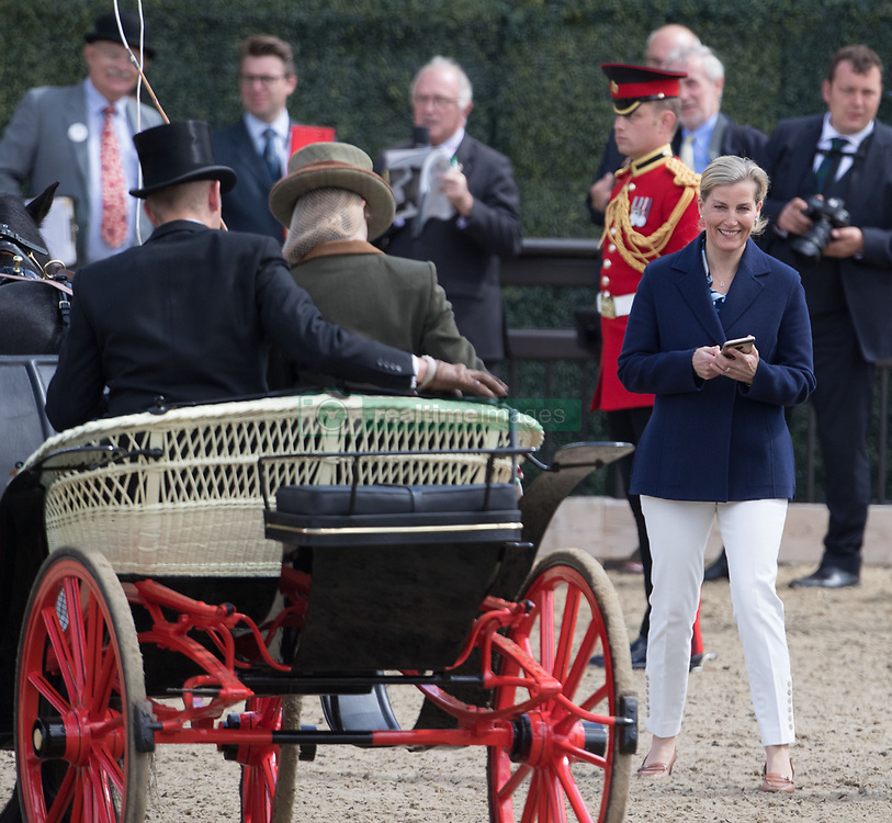 The Countess of Wessex (right) prepares to take a photograph of her daughter Lady Louise Windsor at the Champagne Laurent-Perrier Meet of the British Driving Society at the Royal Windsor Horse Show, which is held in the grounds of Windsor Castle in Berkshire.