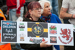 """Rotherham England<br /> 13 September 2014 <br /> EDL supporters outside Rotherham Town Hall before the start of the English Defence Leagues Justice for the Rotherham 1400 March on Saturday Afternoon described by an EDL Facebook Page as """"a protest against the Pakistani Muslim grooming gangs"""" on Saturday Afternoon <br /> <br /> <br /> Image © Paul David Drabble <br /> www.pauldaviddrabble.co.uk"""