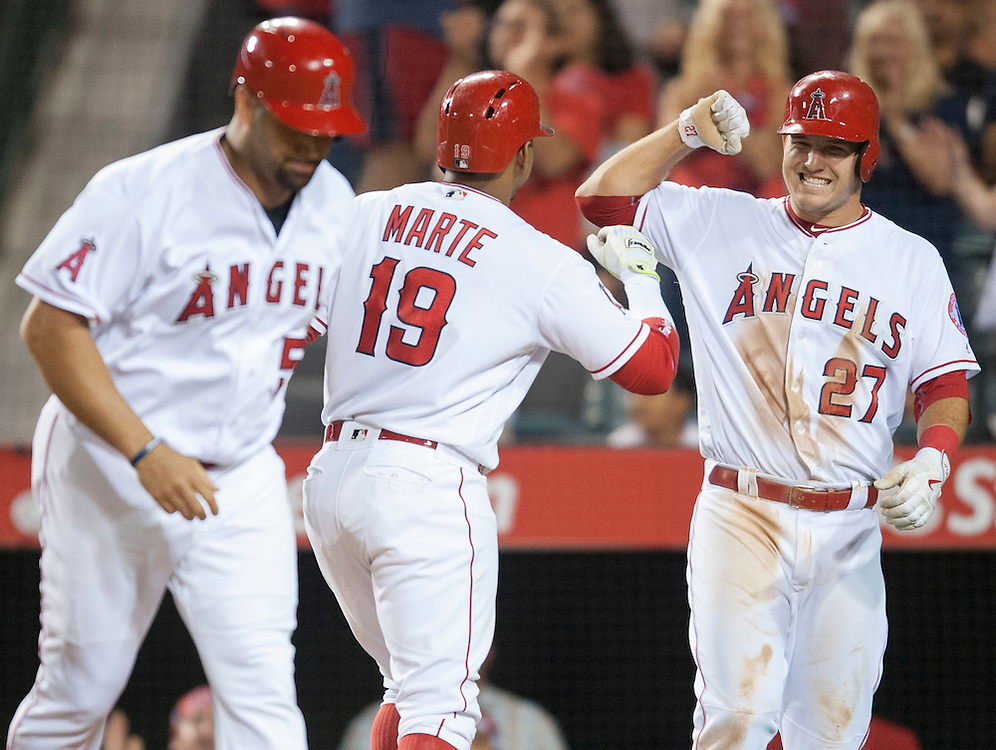 The Angels' Jefry Marte is congratulated by Mike Trout after his three-run home run in the sixth inning against the Oakland Athletics at Angel Stadium on Tuesday.<br /> <br /> ///ADDITIONAL INFO:   <br /> <br /> angels.0803.kjs  ---  Photo by KEVIN SULLIVAN / Orange County Register  -- 8/2/16<br /> <br /> The Los Angeles Angels take on the Oakland Athletics at Angel Stadium.