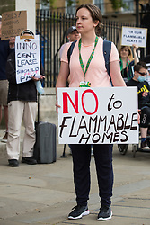 London, UK. 15th July, 2021. Leaseholders and tenants living in unsafe homes protest opposite Downing Street. Some leaseholders are faced with crippling costs to fix safety issues and they called on the government to ensure that their homes are made safe from fire as a matter of priority, to make interim payments and cover fire safety remediation costs and to find a solution with mortgage lenders.