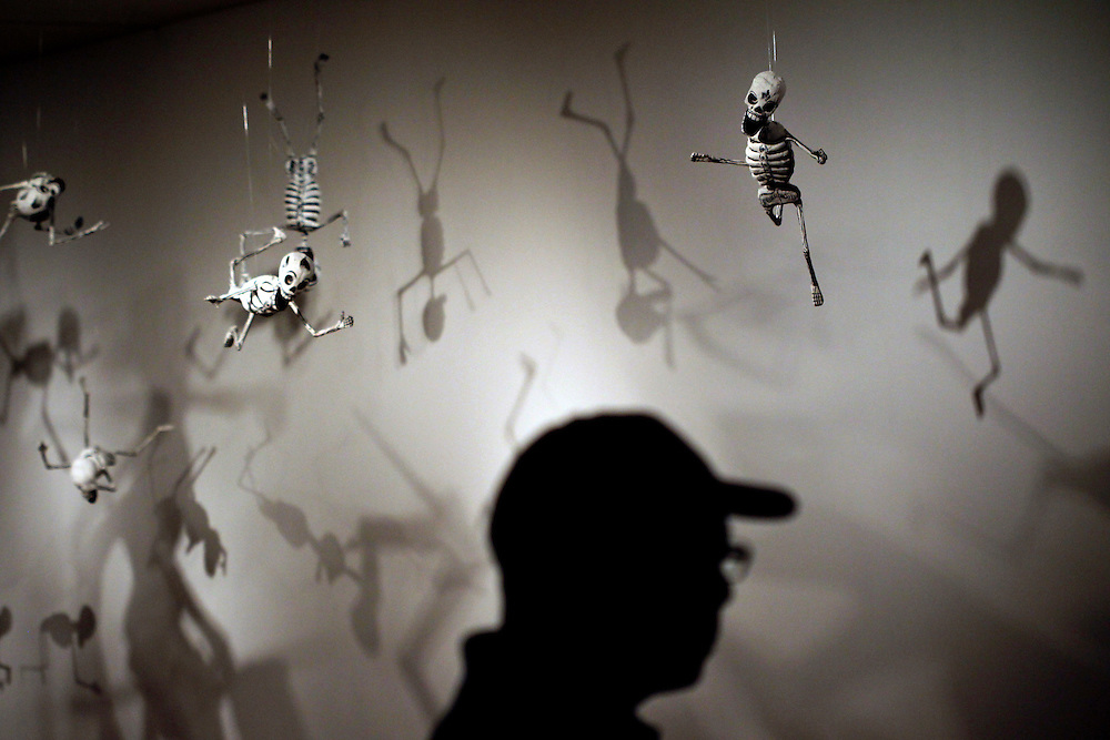 """Papier mache skeletons from """"Don Quixote Skeleton Figures"""" by Pedro Linares and Sons hangs in the exhibit """"Jose Guadalupe Posada: The Birth of Mexican Modernism"""" at the Dallas Museum of Art June 29, 2010.  The piece was inspired by one of Posada's works."""