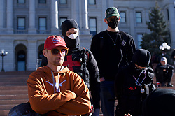 Trump supporter confronted Antifa medics on the steps of the Colorado State Capital during a noontime rally.