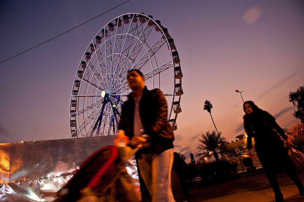 A man pushes a stroller at the entrance of the Al Zawraa' Gardens recreational park in Baghdad.