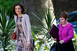 © Licensed to London News Pictures. 12/05/2015. LONDON, UK. Northern Ireland Secretary Theresa Villiers and Leader of the House of Lords Baroness Stowell attending to the first Conservative cabinet meeting after the 2015 general election in Downing Street on Tuesday, 12 May 2015. Photo credit: Tolga Akmen/LNP