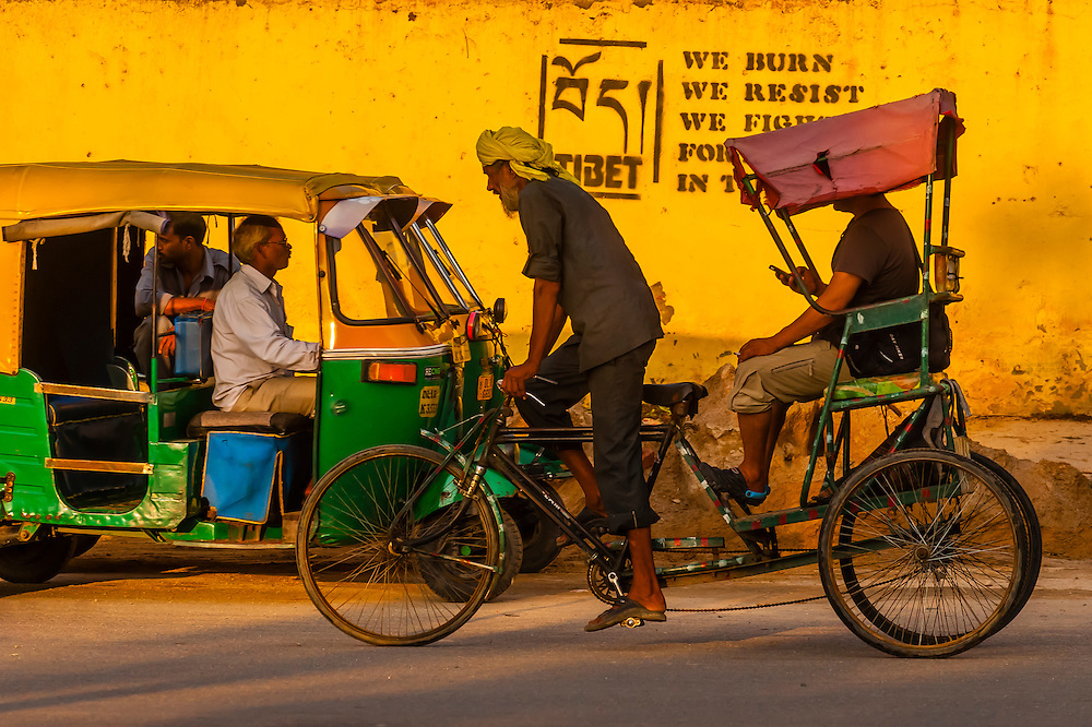 A bicycle rickshaw on the Ring Road in Delhi, India.