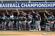03 June 2016: Players on the Nova Southeastern bench waive to a teammate who had gotten a hit. The Nova Southeastern University Sharks played the Millersville University Marauders in Game 13 of the 2016 NCAA Division II College World Series  at Coleman Field at the USA Baseball National Training Complex in Cary, North Carolina. Nova Southeastern won the first game of the best of three Championship Series 2-1.