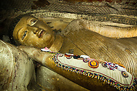 Reclining Buddha at Dambulla Cave Temple - There are total of 153 Buddha statues within the caves. The first cave is called Cave of the Divine King and is dominated by the 14-meter statue of the Buddha, hewn out of the rock.  There is also a dagoba and a spring which drips its water, said to have healing powers, out of a crack in the ceiling.