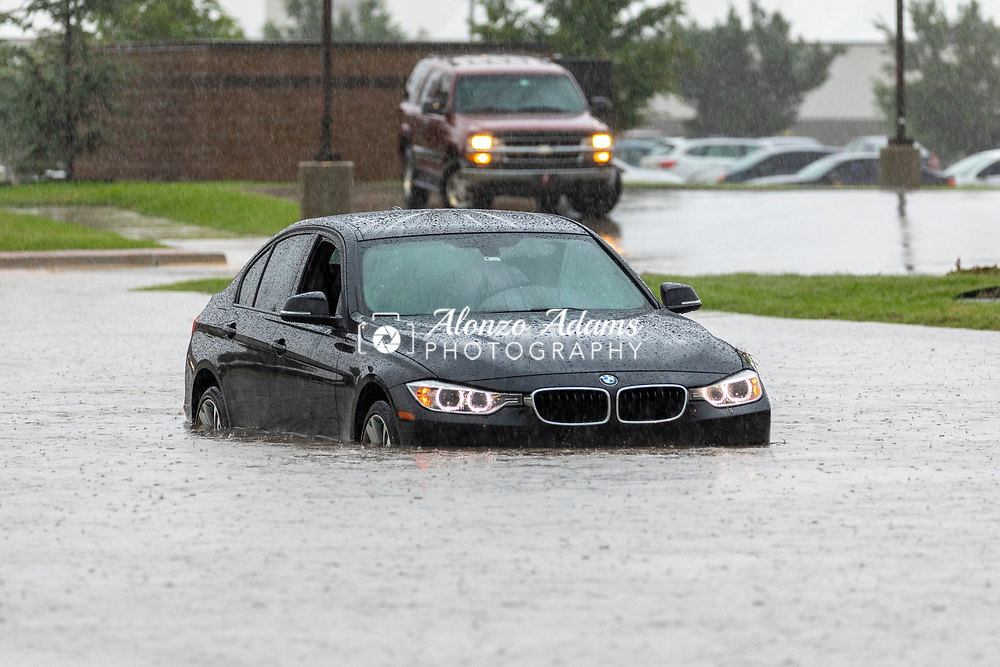 A car stalled out in flood water in Oklahoma City at I-40 and Reno Ave. on Thursday, June 6, 2019. Photo copyright © 2019 Alonzo J. Adams.