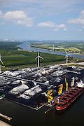 Nederland, Amsterdam, Westpoort, 25-05-2010. Afrikahaven met Spaarnwoude en Noordzeekanaal richting IJmuiden. De bulkcarrier is afgemeerd aan boeien (niet aan de kade), overslag van erts, kolen..Afrikahaven, Spaarnwoude  and North sea canal (in the direction of IJmuiden). The bulk carrier is moored to buoys (not on the quay). Transshipment of ore, coal..luchtfoto (toeslag), aerial photo (additional fee required).foto/photo Siebe Swart