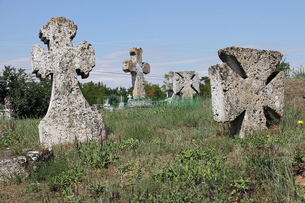 July 4, 2018 - Odesa Region, Ukraine - Stone crosses mark graves at the Great Usatove Cemetery, Odesa Region, southern Ukraine, July 4, 2018. Ukrinform...ODESA REGION. The Great Usatove Cemetery is situated at the top of Mount Shkodova in Usatove village. The necropolis features at least two dozen burial mounds with cromlechs. It is believed that the first burials can be traced back to 2400-2000 BCE. In the 1670s, Cossacks from Zaporizhzhian Sich founded Usatove and eventually laid the foundations of the Great Usatove Cemetery. Stone crosses indicate Cossack graves. As of today, the burial site is gradually decaying and it needs to be protected by the state. (Credit Image: © Nina Liashonok/Ukrinform via ZUMA Wire)