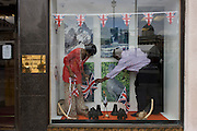 Ugandans from their High Commission hang royal bunting the day before Queen Elizabeth's Diamond Jubilee celebrations in their office window ahead of a weekend of nationwide celebrations for the monarch's Diamond Jubilee. A few months before the Olympics come to London, a multi-cultural UK is gearing up for a weekend and summer of pomp and patriotic fervour as their monarch celebrates 60 years on the throne and across Britain, flags and Union Jack bunting adorn towns and villages.