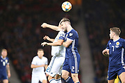 Artem Dzyuba of Russia (22) (Zenit St Petersburg) and Scotland defender Stephen O?Donnell (2) (Kilmarnock) fight for the high ball during the UEFA European 2020 Qualifier match between Scotland and Russia at Hampden Park, Glasgow, United Kingdom on 6 September 2019.