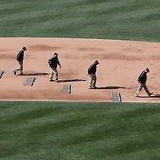 Ground staff prepare the infield at Citi Field, home of the New York Mets during the New York Mets V San Diego Padres Baseball game at Citi Field, Queens, New York. 5th April 2012. Photo Tim Clayton