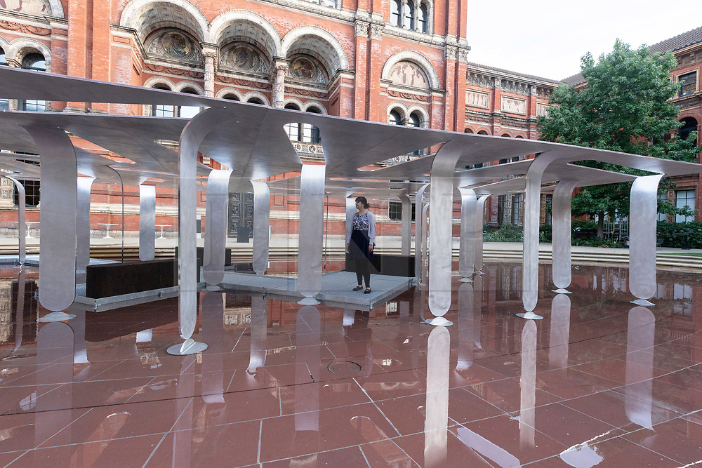 © Licensed to London News Pictures. 17/09/2021. London, UK. An aluminium pavilion titled Between Forests and Skies by Nebbia Works appears to float in the pond of The John Madejski Garden. The work is showing at the V&A as part of the London Design Festival (LDF). Photo credit: Ray Tang/LNP
