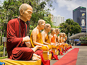 20 APRIL 2015 - BANGKOK, THAILAND:    Large statues of revered Buddhist monks set up for Songkran, the tradition Thai New Year, in Benchasiri Park along Sukhumvit Road in Bangkok.   PHOTO BY JACK KURTZ