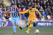 Niall Canavan of Scunthorpe and Rene Howe (r) of Newport County. Skybet football league 2 match, Newport county v Scunthorpe Utd at Rodney Parade in Newport, South Wales on Saturday 1st March 2014.<br /> pic by Mark Hawkins, Andrew Orchard sports photography.