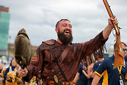 Sep 8, 2018; Morgantown, WV, USA; The West Virginia Mountaineers mascot leads the team through fans as they arrive to the field before their game against the Youngstown State Penguins at Mountaineer Field at Milan Puskar Stadium. Mandatory Credit: Ben Queen-USA TODAY Sports