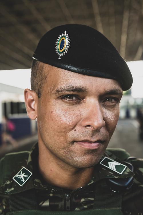 Foz do Iguazu, Brazil - March 28, 2019: Portrait of a Brazilian solider working at the busy border crossing with Paraguay in Foz do Iguazu, Brazil.