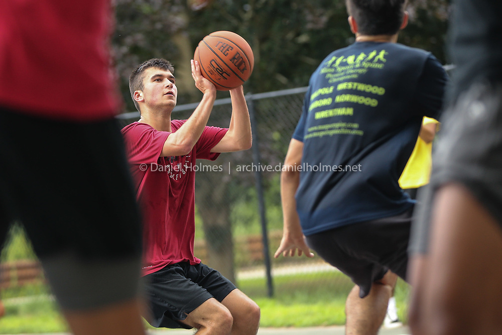 (7/24/20, MILLIS, MA) Holliston High's Spencer Mirken shoots during a pickup game at the Exchange St. basketball court in Millis on Friday. [Daily News and Wicked Local Photo/Dan Holmes]