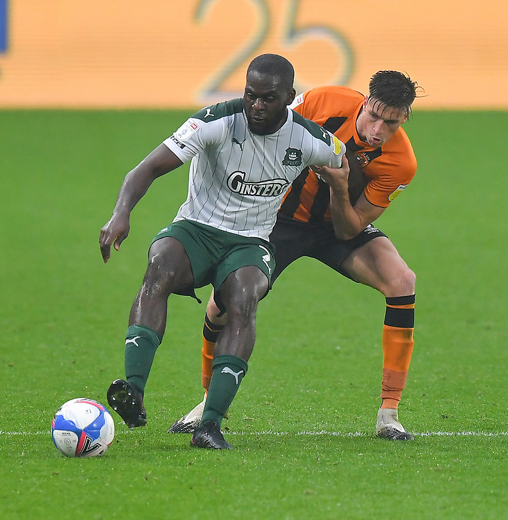 Hull City's Reece Burke battles with Plymouth Argyle's Frank Nouble<br /> <br /> Photographer Dave Howarth/CameraSport<br /> <br /> The EFL Sky Bet League One - Hull City v Plymouth Argyle - Saturday 3rd October 2020 - KCOM Stadium - Kingston upon Hull<br /> <br /> World Copyright © 2020 CameraSport. All rights reserved. 43 Linden Ave. Countesthorpe. Leicester. England. LE8 5PG - Tel: +44 (0) 116 277 4147 - admin@camerasport.com - www.camerasport.com