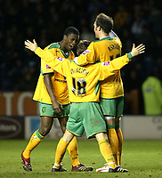 Photo: Chris Ratcliffe.<br />Leicester City v Norwich City. Coca Cola Championship. 31/12/2005. <br />Dean Ashton (R) and Dickson Etuhu celebrate with Paul McVeigh after McVeigh scored.