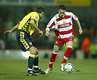 Photo: Aidan Ellis.<br /> Doncaster Rovers v Aston Villa. Carling Cup. 29/11/2005.<br /> Doncaster's Michael McIndoe takes on Villa's Aaron Hughes